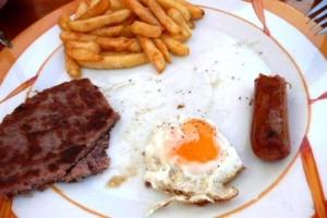 hamburger, sausage, egg & chips at Sa Nacra, Menorca