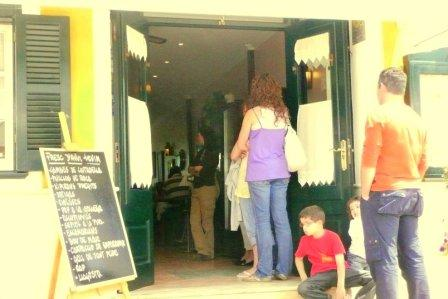 People queuing for lunch at Cafe Balear