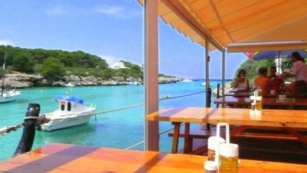 Sa Nacra restaurant/bar, Santandria cove, Menorca, looking west