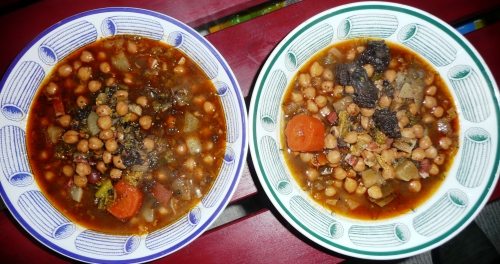 2 bowls of chickpeas and pork products Spanish-style